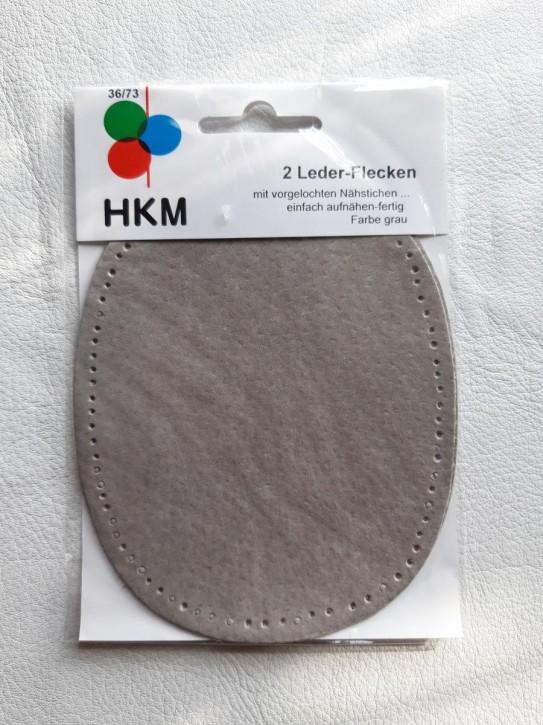2 Lederflicken oval, mit vorgelochten Nähstichen grau
